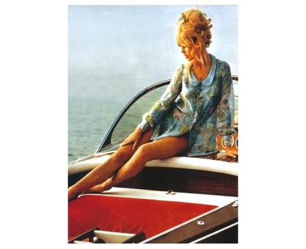 Bardot admires her mahogany inlay