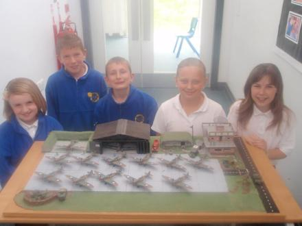 Home-made hangars and airfield accessories complete this group